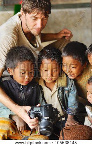 Kids Looking At Photo In Nagaland, India