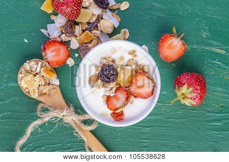 Yogurt With Cereals Muesli and Fresh Strawberries