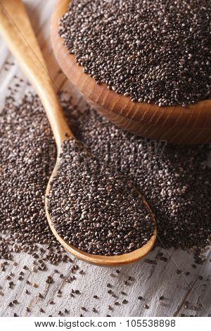 Healthy Chia Seeds In A Wooden Spoon Macro. Vertical