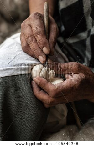 Local Artisan Carving A Meerschaum Stone With A Scalpel