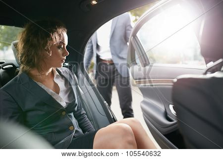 Businesswoman Getting Out Of A Car