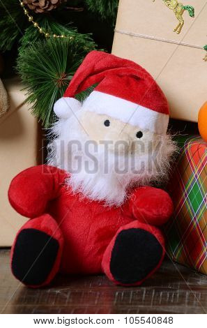 Santa Claus puppet and Christmas tree