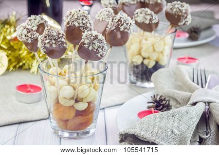 Homemade Apricot And Prunes Lollipops, Covered With Chocolate And Macadamia Nuts