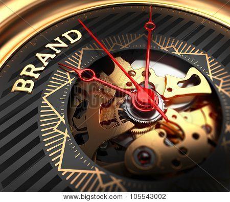 Brand on Black-Golden Watch Face.