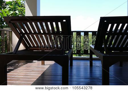 Wooden Deckchair At The Balcony With Forest And Sky View