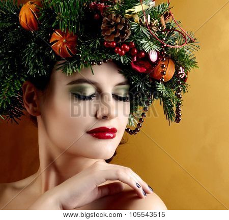 Christmas Woman.  New Year and Christmas Holiday Hairstyle and Make up