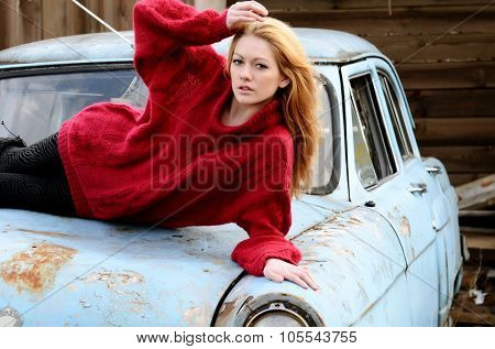 The beautiful woman on old retro car