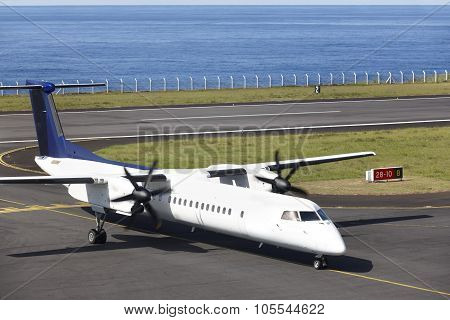 Aeroplane On The Airport Runaway Near The Ocean Just Arrived
