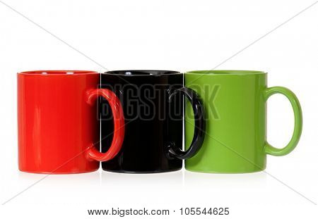 Three cups for coffee or tea, isolated on white background