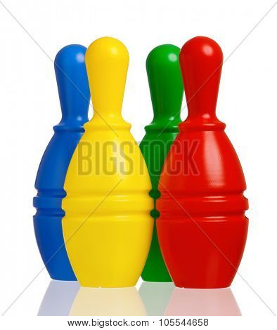Colorful plastic skittles of toy bowling isolated on a white background