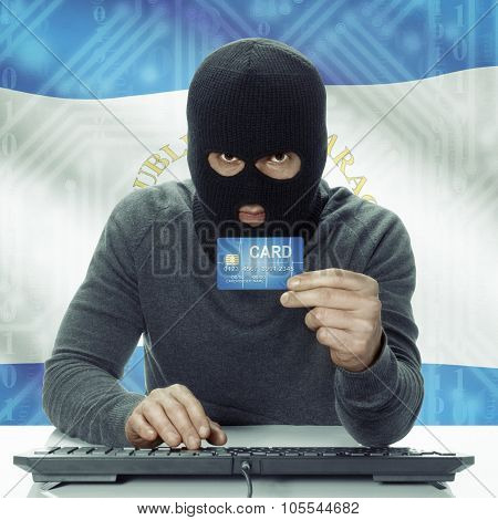 Dark-skinned Hacker With Flag On Background Holding Credit Card - Nicaragua