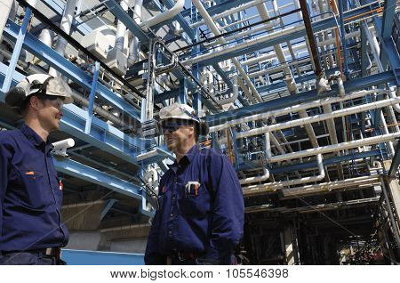 oil and gas workers inside pipelines constructions, refinery industry