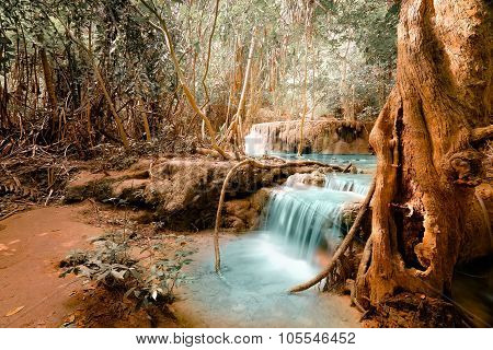 Fantasy jangle landscape with turquoise waterfall at deep tropical rain forest