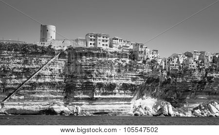 Old Tower And Houses On Rocky Coast In Bonifacio
