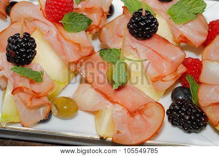 Galia Melon, Melon With Ham, Raspberries, Blueberries, Blackberries And Olives