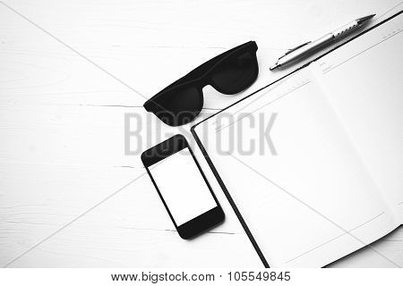 Cellphone With Notebook And Sunglasses Black And White Color Style