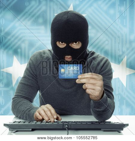 Dark-skinned Hacker With Flag On Background Holding Credit Card - Micronesia