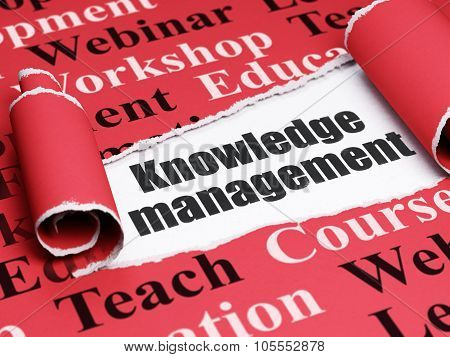 Learning concept: black text Knowledge Management under the piece of  torn paper