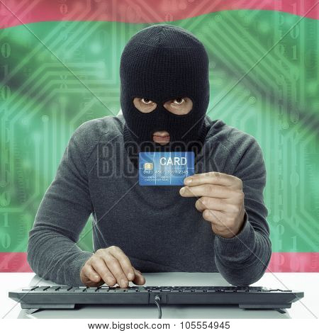 Dark-skinned Hacker With Flag On Background Holding Credit Card - Maldives