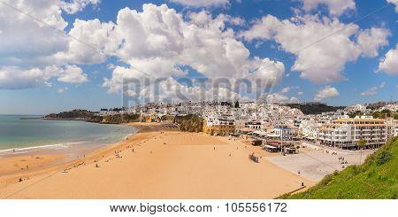 Summer View Of Albufeira Beach Fishermen. White Clouds. Portugal.