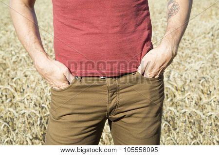 Farmer in rye field close-up sunny day.