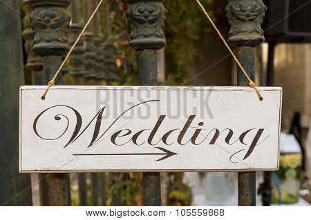 Decorative Plaque With The Inscription Wedding. Shows Direction.