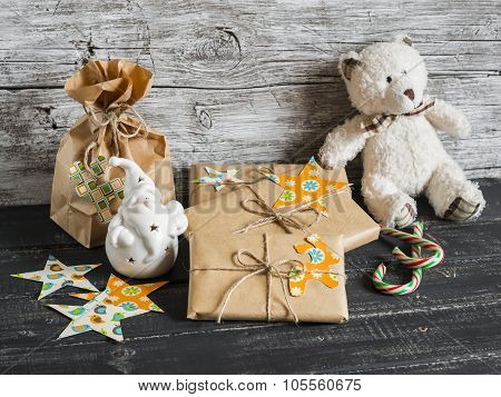 Toy Bear, Homemade Christmas Gifts In Kraft Paper, Candy N Wooden Surfaces. Vintage And Rustic Style