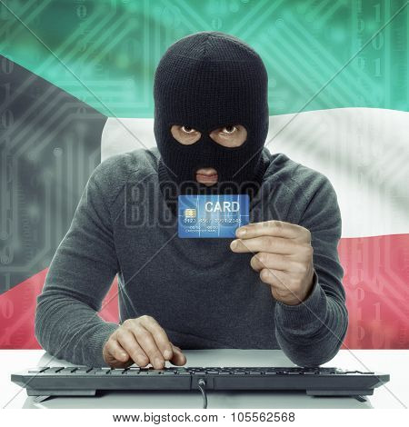 Dark-skinned Hacker With Flag On Background Holding Credit Card - Kuwait