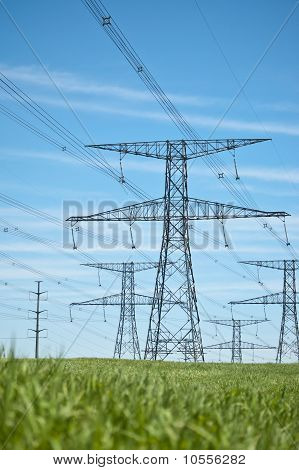 Power Lines With Blue Sky And Green Grass