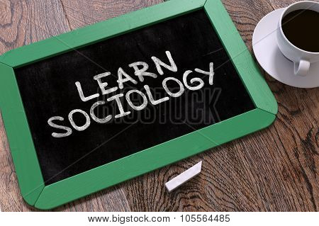 Handwritten Learn Sociology on a Chalkboard.