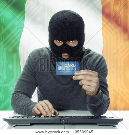Dark-skinned Hacker With Flag On Background Holding Credit Card - Ireland