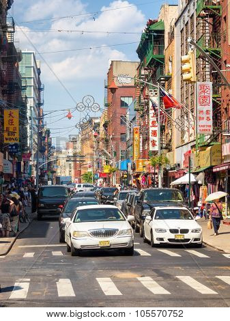 NEW YORK,USA - AUGUST 15,2015 : People and traffic at colorful Chinatown in New York City