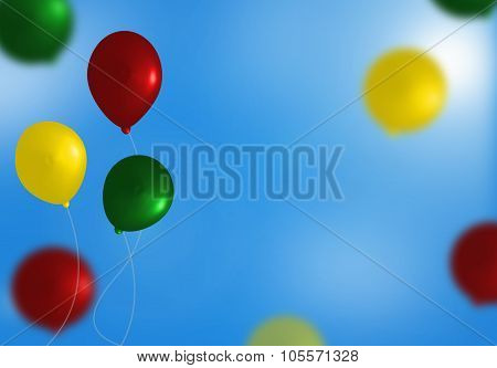Yellow, green and red balloons on blue sky background.