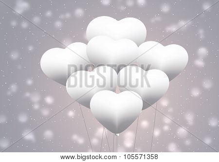 White balloons as love symbol on blurred background.