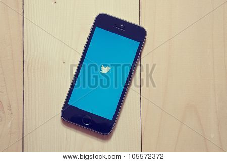 Iphone With Twitter App On Wooden Background