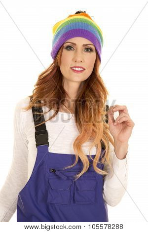 Woman With Red Hair In Coveralls And Hat Hand Up