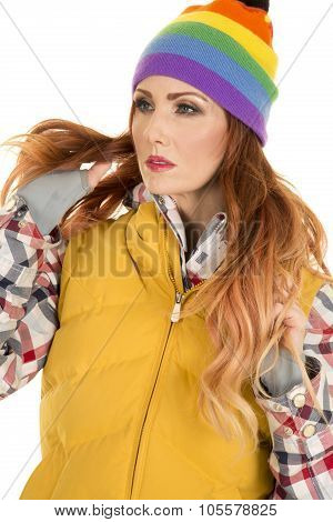 Woman With Red Hair In Yellow Vest And Hat Hands In Hair