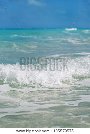 The Wave With Foam At The Shore Of The Ocean