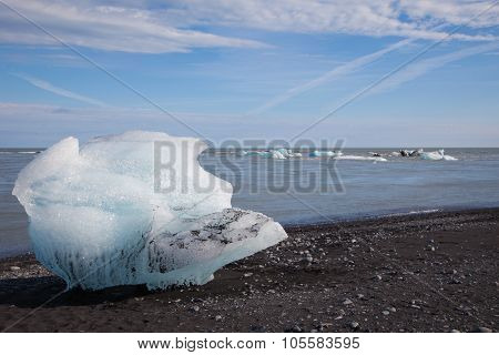 Stranded iceberg  on a lava beach