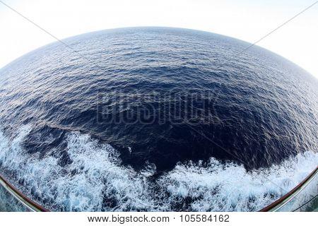 The Western Caribbean Ocean as seen through a 14mm fish eye lens from the deck of a cruise ship.