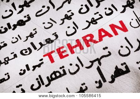 Selective Focus On The Word Tehran, In Farsi And English