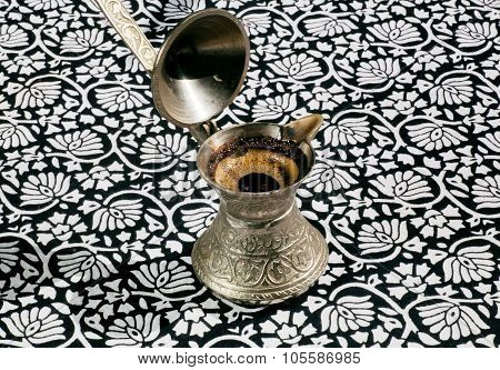 Cooper Turkish Cezve With Fresh Coffee Drink On Tablecloth