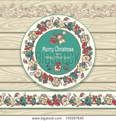 Circle frame and border from Christmas  elements on beige wood background