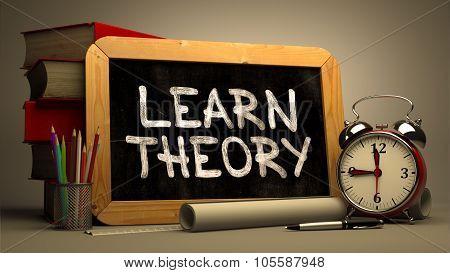 Learn TheoryHandwritten by white Chalk on a Blackboard.