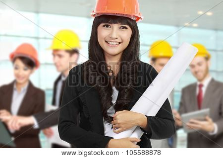Young Businesswoman Wear A Safety Helmet