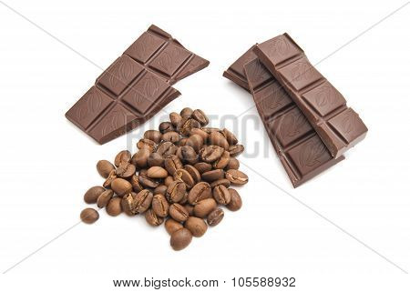Heap Of Coffee Beans And Chocolate On White