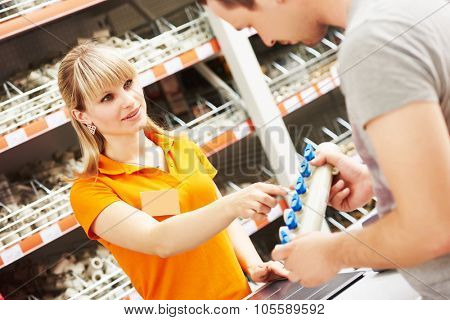 Young woman help purchaser choosing plumber equipment in hardware shopping mall supermarket