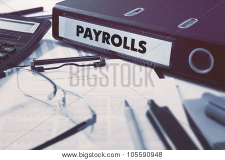 Payrolls on Ring Binder. Blured, Toned Image.
