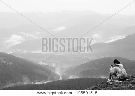 Girl With Mobile Phone On Top Of Mountain