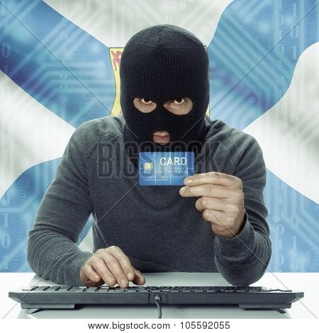 Dark-skinned Hacker With Canadian Province Flag On Background Holding Credit Card - Nova Scotia